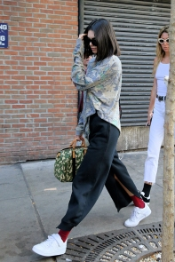 Model Kendall Jenner, wearing red socks, black pants, green top and carrying a camouflage Louis Vuitton bag leaves Gemma Restaurant in New York City, New York. Pictured: Kendall Jenner Ref: SPL1569170 050917 Picture by: Christopher Peterson/Splash News Splash News and Pictures Los Angeles:310-821-2666 New York:212-619-2666 London:870-934-2666 photodesk@splashnews.com